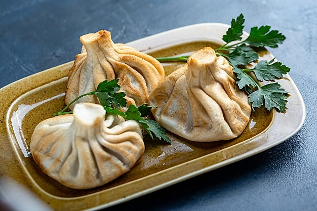 Khinkali (cooked meat and broth packed in dough)